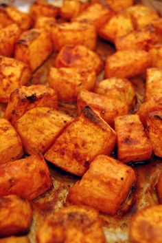 Roasted Sweet Potatoes with Honey and Cinnamon 4 sweet potatoes, peeled and cut into 1-inch cubes 1/4 cup extra-virgin olive oil, plus more for drizzling potatoes after cooked 1/4 cup honey 2 teaspoons ground cinnamon Salt and freshly ground black pepper
