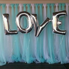 White and Teal tulle back drop with silver LOVE balloons