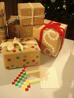 christmas wrapping with sticky dots and hole reinforcements