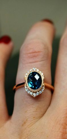 Custom modified diamond halo and London blue topaz center with rose gold. Use a unique alternative center gem to be a little different and keep it affordable, too. Joseph Jewelry Bellevue Seattle, WA Designers of Fine Custom Jewelry Custom Jewelry, Gold Jewelry, Jewelry Box, Jewelry Accessories, Fine Jewelry, Jewelry Rings, Handmade Jewelry, Cheap Jewelry, Inexpensive Jewelry
