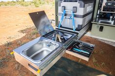The kitchen slide-out has a sink, drawer and space for a refrigerator Toy Hauler, Trailer Tent, Trailers, Tent Camping, Refrigerator, Offroad, Camper, Drawer, Road Trip