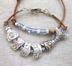 enim Blue Fish in leather - coastal bracelet w silver segmented fish and beads on natural leather by SeaSide Strands