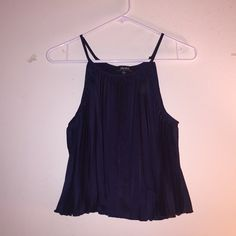 Lulu's Navy Pleated Crop Top XL New in plastic packaging. Only taken out for pic and to try on-otherwise never worn. Lulu's Navy Blue Pleated Crop Top XL. Great to wear on a night out with a pencil skirt or pants and heels. Lulu's Tops Crop Tops