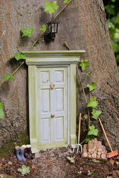Fairy Doors in the Forest Tutorial for how to use doll house materials to create magical fairy doors and play areas in your garden or yard