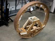 This is my Mobius Machine. It is a wind-up wooden gear driven wheel. I built it for my Sculpture class. Check you my other art at www.NateObee.com