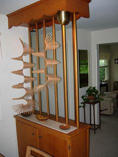 Room divider, lol, like the motel rooms in the series Supernatural with their ever changing dividers :) :)