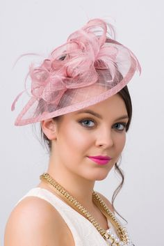 Timeless glamour. This sassy fascinator gives a nod to vintage style with a bouncy mesh ribbon and flighty feathers. With its classic sinamay mesh shape and elegant look it will be your go-to fascinat