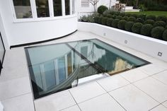 External View Of Walk On Glass Floor Above Basement Renovation  Www.iqglassuk.com