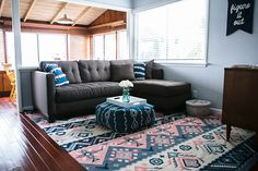 Ilana from Team LC shows how she positioned a rug in her living room.