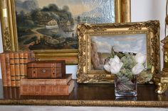 Lovely vignette with antique books & art - Dana Wolter Interiors