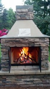 Beautiful DIY idea: Add stone facing to Perfect Outdoor Fireplace Kit from www.MantelsDirect....