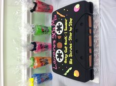 My amazing 30th birthday cake in the shape of a cassette tape and behind the cake are what my favors were, inside the cups were 90's themed candy.