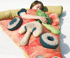 You've never truly experienced pizza until you slept in it. Perfect for kid's sleep overs, these hand made comfy pizza slice sleeping bags can be custom ordered with your choice of toppings that comes either as extra pillows or as fixed blanket decorations.