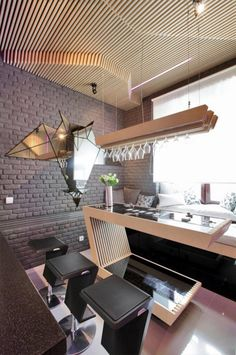 http://taizh.com/wp-content/uploads/2015/09/furturistic-Home-Bar-Interior-Design-with-pendant-lamp-above-glass-table-bar-plus-black-bar-stools-idea.jpg