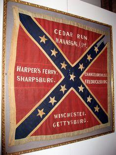 Confederate Battle Flag. Believed to be a La. Regimental Flag with battle honors of Cedar Run. Manassas. (2nd) Harper's Ferry.  Sharpsburg. Chancellorsville. Fredricksburg. Winchester. Gettysburg