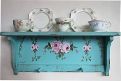 -Handpainted plate rack holds some of my mismatched china and teacups at my cottage
