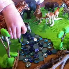 Our invitation to play today - playdough, animals, glass beads and sticks. Inspiration found at The Artful Parent