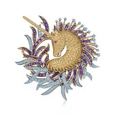 Gorgeous Unicorn Clip Glistening diamonds, sapphires and amethysts complement and enhance the unicorn's magical mystique. Clip in 18k gold and platinum with round brilliant diamonds, round amethysts and round yellow and pink sapphires. Unenhanced yellow sapphires, carat total weight 11.95; amethysts, carat total weight 10.80; diamonds, carat total weight 3.77; pink sapphire, carat total weight .06.