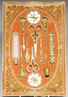 10-Piece Victorian Sewing Kit. Includes a pair of scissors, a pair of ear wax extractors, one needle case, one perfume bottle, one thimble, and other sewing accessories