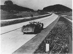 """""""The idea for the autobahn was conceived in the late 1920s during the Weimar Republic, but construction was slow, due to economic problems and lack of political support. The first road was completed in 1932 between Cologne and Bonn. """"Days after the 1933 Nazi takeover, Hitler embraced an ambitious autobahn construction project. The autobahns were not intended as military infrastructure as often stated because all major military transports in Germany were done by train to save fuel."""