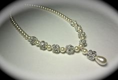 Pearl drop necklace // Bridal jewelry // Large sparkling crystal rhinestone fireballs // Formal Jewelry // Ivory pearl necklace // on Etsy, $59.99