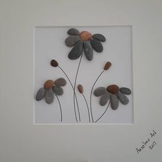 Pebble Flowers - Give your family or friends a really special and personal gift that they surely wont get from anyone else. This pebble flower brunch is also a perfect present for Valentines Day or for a birthday. ✿ Handmade pebble pictures from South Devon, UK ✿ Comes with black or