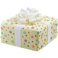 Dazzling Dots Cake. This cake is gifted with eye-popping color and a fun attitude thanks to the fondant/gum bow and dazzling dotted sprinkle accents. A great way to top off any birthday celebration!