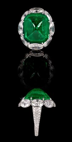 14,18ct Natural Colombian Cabochon-Cut Emerald Ring With White Oval Diamond Surround. Total Diamond Weight 6,72ct. David Morris.