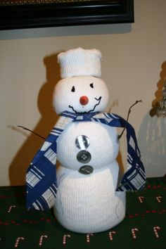 Tube Sock Snowman, This snowman was made from a tube sock filled with rice.  His face is drawn with fabric paint, his arms are twigs, and his scarf is scrap fabric.  We also gave him some buttons., Holiday Project