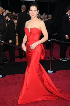Pin for Later: 11 Times Sandra Bullock Earned the Title of Most Beautiful Woman She Made Our Hearts Race in Red At the 2011 Oscars, Sandra sizzled in a strapless Vera Wang gown with a structured bodice and back bow detail.