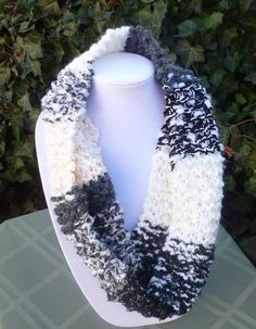 Ebony and Ivory    This scarf is knit from five different yarns with a variety of textures.    It measures 30 around and is 7 1/2 wide.    The