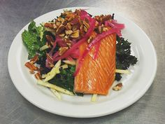 """Smoked Salmon and Kale Salad - """"This is a signature dish that highlights the fresh Pacific Northwest salmon. It is served at Sunnyside Medical Center as well as the Westside Medical Center, our brand new hospital in Hillsboro Oregon,"""" says Greg Gates, regional executive chef for Kaiser Permanente.  """"The classic smoked salmon is always too high in sodium, so we purchased a smoker and came up with our own brine, which was lower in sodium, and then we increased the smoking time to add more…"""
