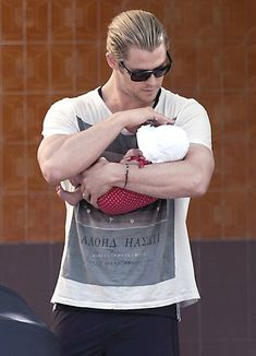 """""""Thor"""" star Chris Hemsworth's daughter India Rose looks so little in his massive arms as he lovingly holds her close. Hemsworth carried his ..."""
