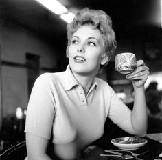 Kim Novak drinking a cup of tea