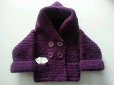 Hand knitted babys jacket made in Deep Violet    Double breasted jacket fastens with four functional Violet buttons.    Length of sleeves are