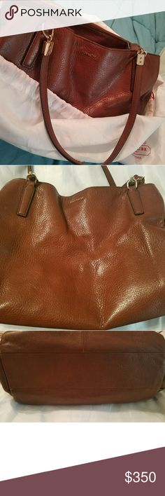 Coach gorgeous leather handbag Coach beautiful soft brown leather handbag  8.5 height  across and 15.5 length.  Red interior with 3 compartments, comes with dust bag in excellent condition. Coach Bags Shoulder Bags