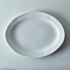 The (untucked) classic white oxford shirt of serveware.