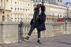 Sung Hee Kim in Paris in dotted socks and show hair