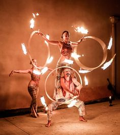 Acro Fire Hooping Trio! Photo by Zen Panda Photography. • hooping.org