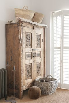 Beautiful antique wood cupboard with decorative trim.