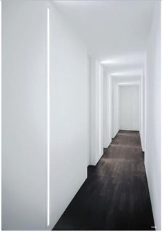 Slot Recessed Wall Light - Fontana Arte  The light just pulls the eye down the hallway... beautiful effect!