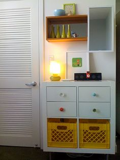 IKEA Expedit 2x2 with Anthropologie knobs, milk crates for laundry from the Container Store. Its also on 4 legs to look more like a dresser.
