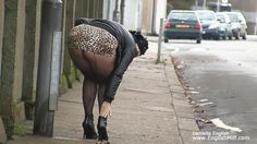 Public upskirt seamed fishnet pantyhose tights, mini skirt and heels sexy outdoor arse flash in the street. Women in short skirts, public pantyhose video.