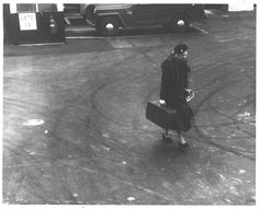 Eleanor Roosevelt carrying her suitcase at LaGuardia Airport, New York, New York. Lawrence W. Jordan photo. 1960.