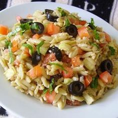 This orzo salad includes artichoke hearts, tomatoes, olives, and Parmesan cheese tossed in a simple balsamic dressing for a nice lunch or dinner side dish.