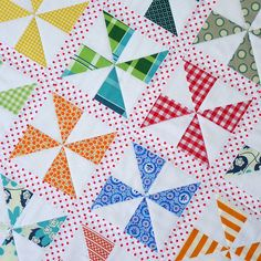 Red Pepper Quilts: Pinwheels on Parade Quilt and New Quilt Pattern - Love the polka dot sashing.
