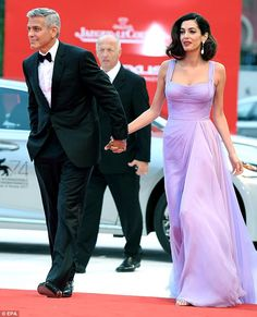 Movie star: Meanwhile, it proved to be a truly glamorous affair as he arrived on the red carpet with wife Amal for the Suburbicon premiere earlier on in the day