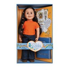 Alexi is set up for an urban adventure in her denim flared pants, orange t-shirt with string ties and wonderfully comfortable brown suede mules. Eight tiny orange hair clips decorate her lovely long hair.  This premium quality doll is 46cm (18 inches) tall with a soft, huggable body and posable arms and legs. Her eyes open and close.