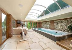 Indoor Endless Pool Swim Spa workout room with gorgeous overhead custom windows.