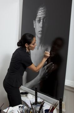 "Shirin Neshat in her studio working on Roja from ""The Book of Kings"" series   